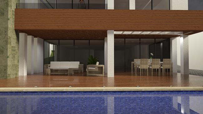 vista de la piscina y terrazas de la vivienda